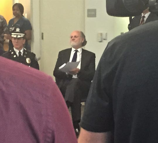 Former Gov. Jon Corzine awaits his turn to speak at a political pep rally in Camden Thursday.