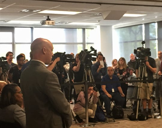 A wall of cameras faces speakers at an event touting Camden's progress Thursday.