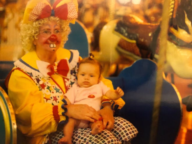 Lois Herman holds her great-granddaughter Victoria at Clownfest in Seaside Heights.