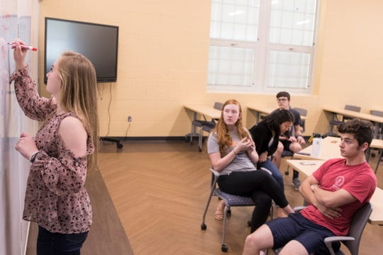 Alison Gossman writes down the ideas given to her by her peers about what they can do to try and show people the positive things kids their age can do in Chillicothe during a meeting of the Ross County Youth Council at Chillicothe Intermediate School on May 15, 2019.