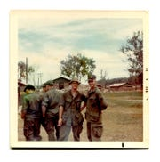 U.S. Army soldiers Dennis Harvey and Medal of Honor recipient Charles Clinton Fleek of Petersburg, Kentucky, pose for a snapshot in December 1968, at Dau Tieng base camp in south Vietnam.