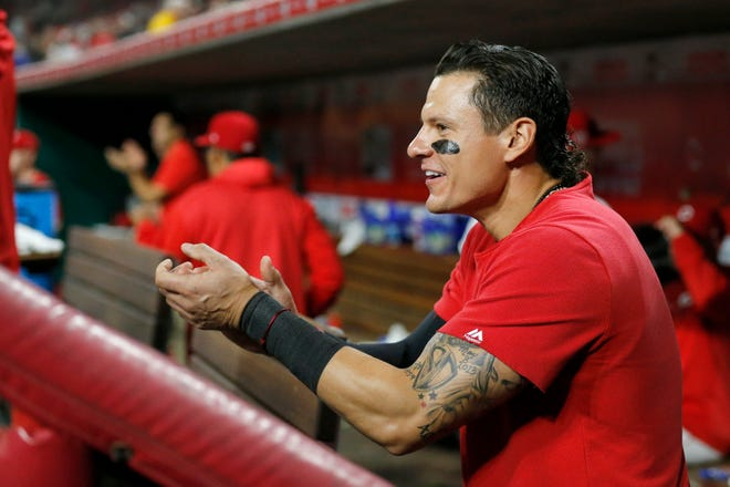 Cincinnati Reds second baseman Derek Dietrich (22) cheers from the bench in the 10th inning of the MLB National League game between the Cincinnati Reds and the Chicago Cubs at Great American Ball Park in downtown Cincinnati on Wednesday, May 15, 2019. The Reds won 6-5 on a walk-off single by Yasiel Puig in the bottom of the 10th inning.