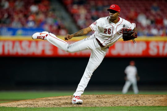 Cincinnati Reds relief pitcher Raisel Iglesias (26) delivers a pitch in the ninth inning of the MLB National League game between the Cincinnati Reds and the Chicago Cubs at Great American Ball Park in downtown Cincinnati on Wednesday, May 15, 2019. The Reds won 6-5 on a walk-off single by Yasiel Puig in the bottom of the 10th inning.