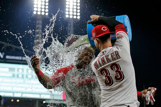 The Reds beat the Cubs 6-5 on a walk-off single by Yasiel Puig in the bottom of the 10th inning. Here, Puig is seen being doused by teammate Jesse Winker.