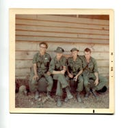 "Wayne Curtis, U.S. Army Sgt. Charles Clinton Fleek, a man the photographer Dennis Harvey knew as ""Tex"" and a man last name of Carpenter sit with black label beers in hand in December 1968, at Dau Tieng base camp. The Charlie Company squad leader was killed May 27, 1969, in Vietnam when he jumped on a grenade."