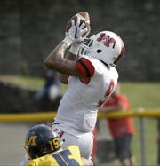 Wayne's L'Christian Smith catches a touchdown pass during the Warriors  win over Moeller.