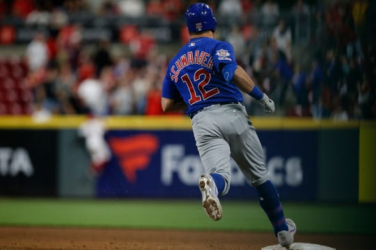 Chicago Cubs left fielder Kyle Schwarber (12) rounds the bases on a solo home run to right field in the eighth inning of the MLB National League game between the Cincinnati Reds and the Chicago Cubs at Great American Ball Park in downtown Cincinnati on Wednesday, May 15, 2019. The Reds won 6-5 on a walk-off single by Yasiel Puig in the bottom of the 10th inning.