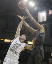 Lakota East's Jon Fox (23) battles Wayne's L'Christian Smith (0) for a rebound during their district final in 2016.