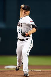 Arizona Diamondbacks starting pitcher Zack Greinke (21) pitches against the Atlanta Braves during the first inning at Chase Field.