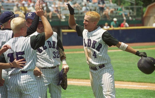 JUNE 5, 1999: Jeff Lammers (4) of Cincinnati Elder High School is greeted by his teammates after driving in the winning runs against Cuyahoga Falls during the seventh inning of the Ohio High School Division I championship at Canton, OH, Saturday, June 5, 1999. Elder won the game 4-2.