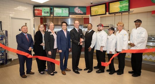 """During a brief ceremony, Grill Nation and Zona Mexicana were rebranded """"Burger 931"""" and """"Tu Taco"""" respectively."""