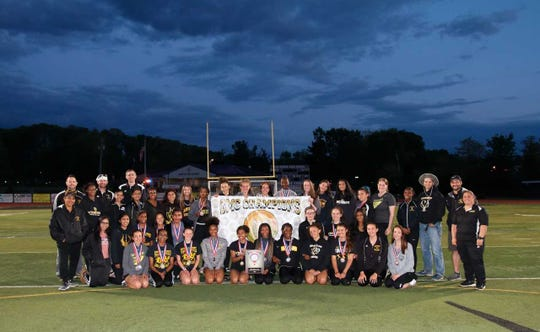 The South Brunswick girls track team poses after winning the 2019 GMC Championship.