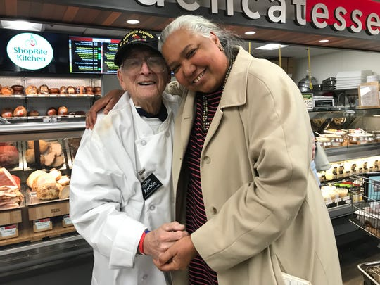 Archie Fagan, here with Elizabeth Martin, is a living legend. At 93, the WWII veteran is an iconic fixture in the community. Working full-time as a service manager at the ShopRite of Flemington for 25 years, Fagan does not intend to retire — ever.