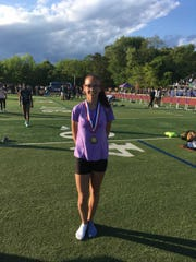 Edison's Cynthia Boryeskne poses after winning the 2019 GMC 800 title.