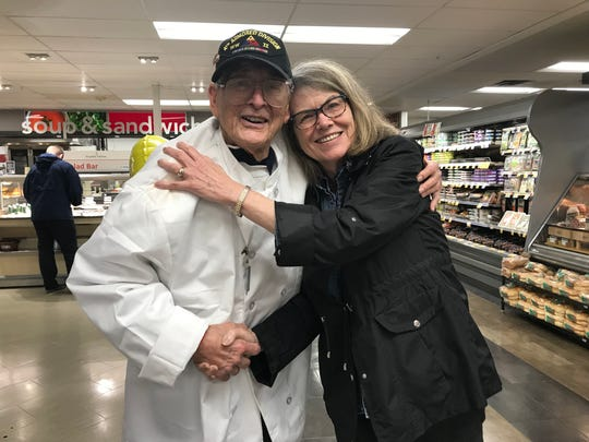 Archie Fagan, here with Cindy Denig, is a living legend. At 93, the WWII veteran is an iconic fixture in the community. Working full-time as a service manager at the ShopRite of Flemington for 25 years, Fagan does not intend to retire — ever.