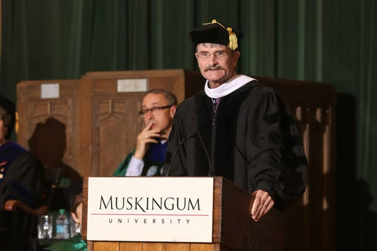 Greg Dams addresses students during graduate commencement ceremonies recently at Muskingum University.