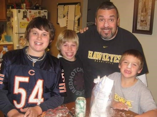 Owner of 3 Sons Bar & Grill, Dave Anders and his three sons, Brody, Davis and Aidan.