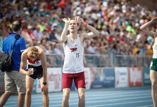 Ankeny senior Tim Sindt simulates a free throw shot as he celebrates a Class 4A state title after winning the to the Class 4A 3,200-meter run during the 2019 Iowa high school track and field state championships at Drake Stadium in Des Moines on Thursday, May 16, 2019.