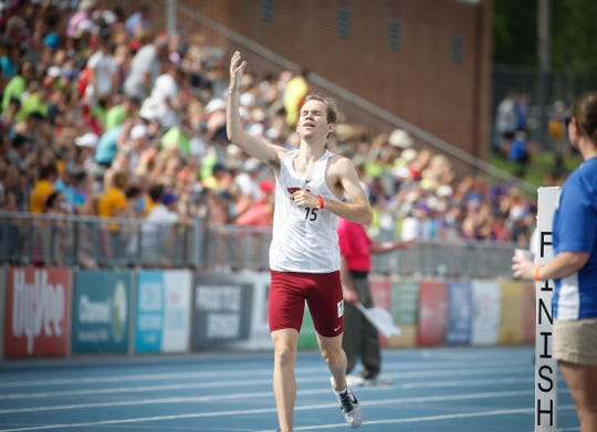 Ankeny senior Tim Sindt celebrates a Class 4A state title after winning the to the Class 4A 3,200-meter run during the 2019 Iowa high school track and field state championships at Drake Stadium in Des Moines on Thursday, May 16, 2019.