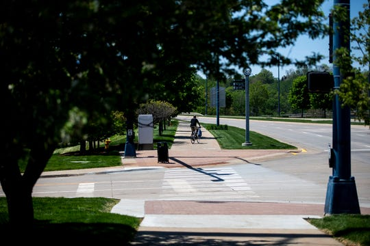 A man pedals up the Meredith Trail at the intersection of SW 16th Street and Martin Luther King Jr. Parkway on Thursday, May 16, 2019, in downtown Des Moines. The city redesigned the cross walk and curb on the southeast side of the intersection after a series of accidents there.