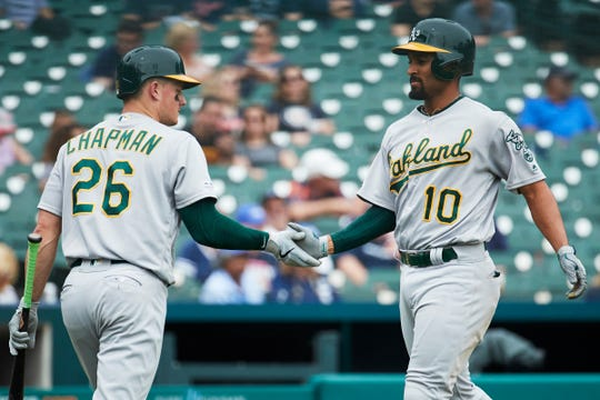 Athletics shortstop Marcus Semien, right, celebrates with Matt Chapman after hitting a three-run home run in the seventh inning of the Tigers' 17-3 loss to the A's on May 16, 2019, at Comerica Park.