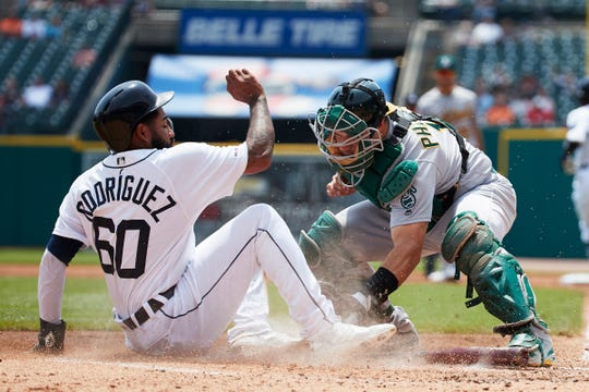 Tigers shortstop Ronny Rodriguez is tagged out by Athletics catcher Josh Phegley in the second inning on Thursday, May 16, 2019, at Comerica Park.
