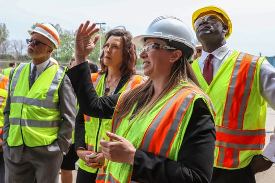 Michigan Department of Transportation Deputy Chief Bridge Engineer Rebecca Curtis, center right, gives a tour to Wayne County Executive Warren Evans, Michigan Governor Gretchen Whitmer, and MDOT Director Paul Ajegba of the Miller road bridge in Dearborn, Mich. to inspect the bridge on Thursday, May 16, 2019. Governor Whitmer toured the bridge to address public safety concerns and and the need for increased funding to fix Michigan's crumbling infrastructure.