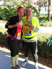 Gary Dueweke of Sterling Heights, pictured with his daughter Cortney, is the New Balance Runner of the Week.