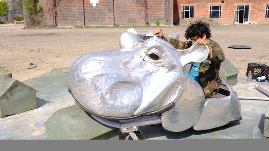 Artist Juan Martinez created an interactive sculpture of large metal hippopotamuses.