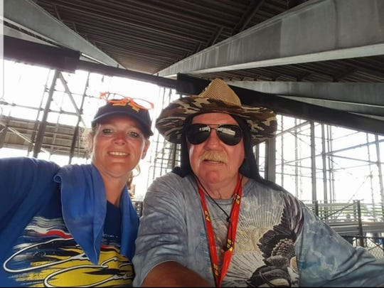 Lena Wood and her father, Ray Wood, attend the FireKeepers Casino 400 race at Michigan International Speedway each year on the second Sunday of June — a week before Father's Day. 'It's like we get two Father's Days,' Lena said.