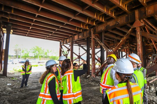 Gov. Gretchen Whitmer, Michigan Department of Transportation Director Paul Ajegba and Wayne County Executive Warren Evans tour the Miller Road bridge in Dearborn with MDOT Deputy Chief Bridge Engineer Rebecca Curtis to inspect the bridge on Thursday, May 16, 2019.
