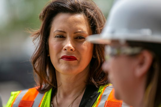 Michigan Governor Gretchen Whitmer, Michigan listens to MDOT Deputy Chief Bridge Engineer Rebecca Curtis as they inspect the Miller road bridge in Dearborn, Mich. on Thursday, May 16, 2019. Governor Whitmer toured the bridge to address public safety concerns and and the need for increased funding to fix Michigan's crumbling infrastructure.
