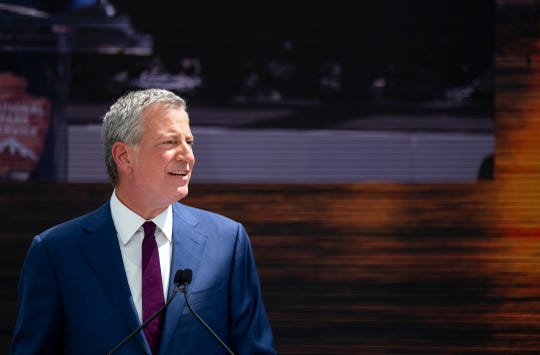 New York Mayor Bill de Blasio speaks during the official dedication ceremony of the Statue of Liberty Museum on Liberty Island Thursday, May 16, 2019, in New York.