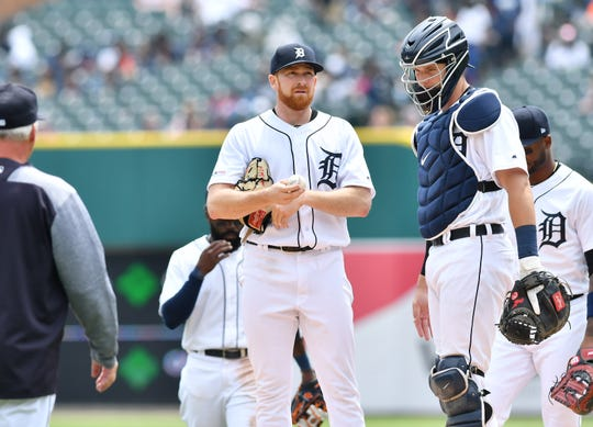 Tigers pitcher Spencer Turnbull and catcher Grayson Greiner wait for pitching coach Rick Anderson to make his way to the mound in the third inning Thursday at Comerica Park.