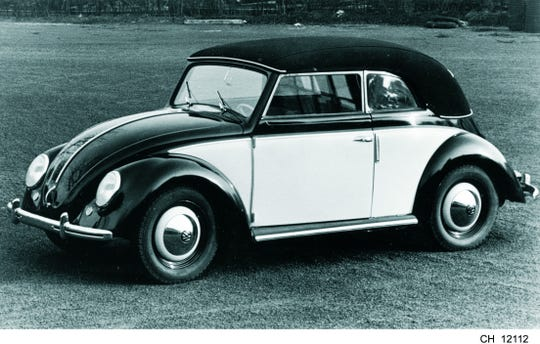 A VW Beetle Cabriolet is shown in 1949, the first year Beetles were sold in the U.S.