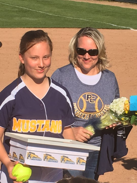 Sophie Varney and her mom Kim are pictured between games on Tuesday.