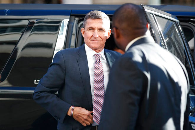In this Dec. 18, 2018, file photo, Trump's former national security adviser Michael Flynn arrives at federal court in Washington. Flynn told the special counsel's office that people connected to the Trump administration and Congress contacted him about his cooperation with the Russia investigation.