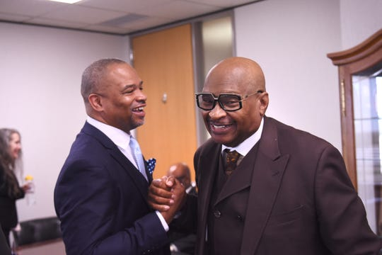 Tom Adams, president and CEO for Chance for Life, shakes hands with Darryl Woods, left, in Southfield.