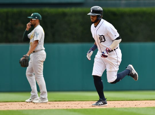 The Tigers' Dawel Lugo rounds the bases after his three-run home run in the ninth inning Thursday against the A's.