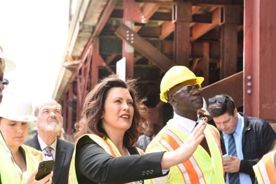 Gov. Gretchen Whitmer, left, tours a crumbling Contrail bridge at Miller Road with MDOT Director Paul Ajegba on Thursday.
