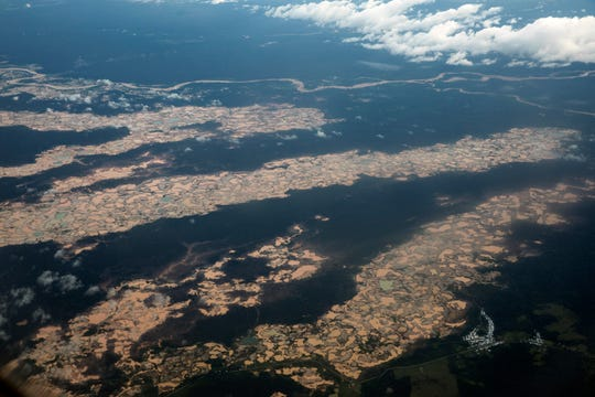 This March 26, 2019 photo shows an aerial view of thousands of destroyed hectares of Amazon jungle by illegal miners, in the Tambopata province.
