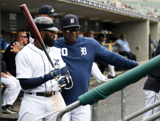 Tigers hitting coach Lloyd McClendon, right, with Josh Harrison.