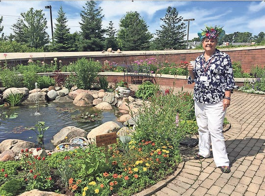 Nancy Szerlage at the OPC  garden