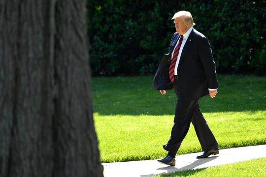 "President Donald Trump walks towards Marine One on the South Lawn of the White House, Thursday, May 16, 2019. Privately, Trump has said he doesn't want war with Iran, one person familiar with the matter said. ""I hope not,"" Trump told reporters on Thursday when asked about the prospect of war."