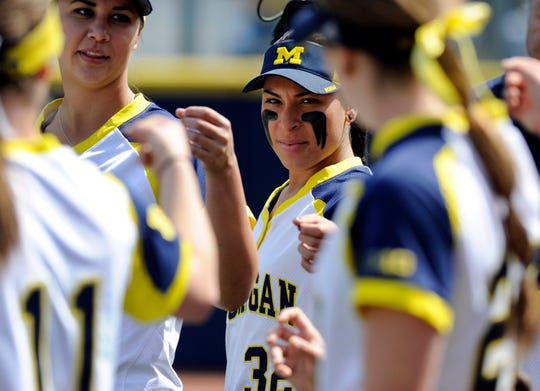 Michigan softball second baseman Sierra Romero, center, and her teammates gather for a team huddle before the start of a game against Rutgers at the Wilpon Complex in 2016.