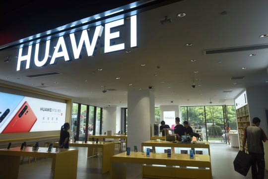 Shoppers browse smartphones at a Huawei retail store in Hangzhou in eastern China's Zhejiang province, Thursday, May 16, 2019.