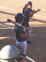 Portage Central coach Lisa Kiino cheers on her team as Sophie Varney waits on deck.