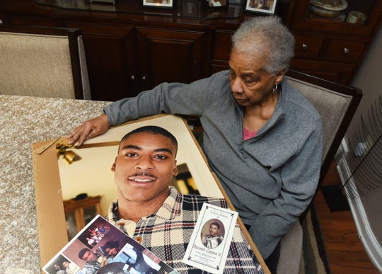 Diane Cooper of Detroit looks at a photograph of her son, DeCondi, who was killed in 1998.