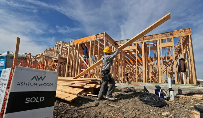 A construction crew works on an already sold new home in north Dallas.