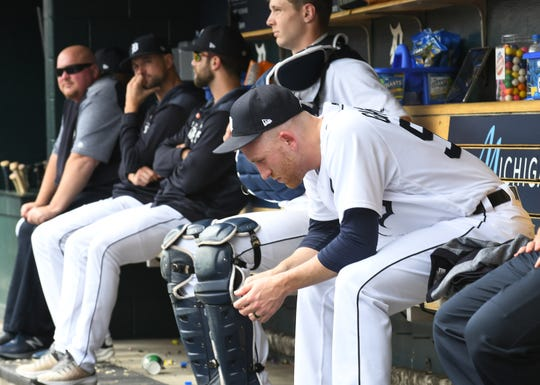 Tigers pitcher Reed Garrett sits in the dugout in the seventh inning. He allowed four runs on four hits in one inning.